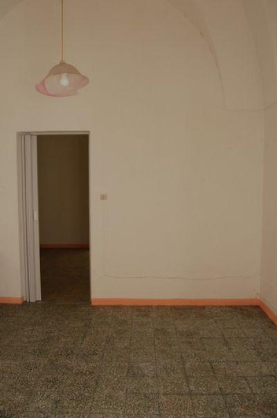 Casa con Pajara retrostante